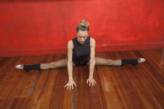Ballerina Practicing Split In Dance Studio Stock Photos