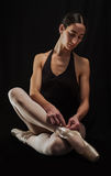 Ballerina preparing her ballet shoes Stock Images