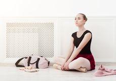 Ballerina puts on pointe ballet shoes, stock images