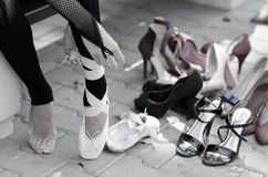 Ballerina Putting Pointe Ballet Shoes on her Feet Stock Image