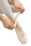 Ballerina putting on pointes Royalty Free Stock Image