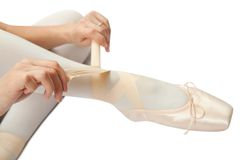 Ballerina putting on pointes Royalty Free Stock Photo