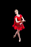 Ballerina in red tutu on isolated black Royalty Free Stock Images