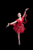 Ballerina in red tutu on isolated black Royalty Free Stock Image