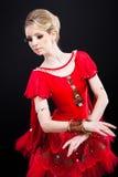 Ballerina in red tutu posing on black Royalty Free Stock Photography