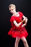 Ballerina in red tutu posing on black Stock Photo