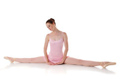 Ballerina resting. On the floor against a white background Stock Images