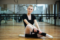 Ballerina resting on the floor Royalty Free Stock Images