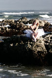 Ballerina on rocks. Ballerina sitting on rocks Stock Images