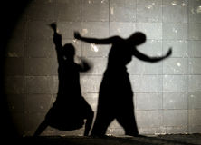 Ballerina shadow. The shadow of a couple of ballet dancers royalty free stock photos