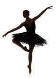 Ballerina silhouette making ballet pirouette against white background. A ballerina silhouette making pirouette against white background, isolated. Professional Royalty Free Stock Photos