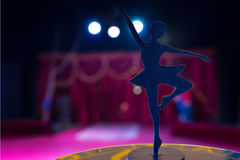 Ballerina Silhouette Statue Spotlit on Empty Stage Royalty Free Stock Photography