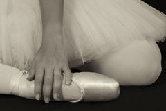 Ballerina sit down on floor to put on slippers prepare  for perf Royalty Free Stock Image