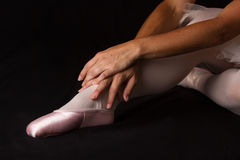 Ballerina sit down on floor to put on slippers prepare  for perf Royalty Free Stock Photo