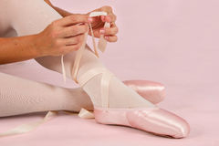 Ballerina sit down on floor to put on slippers prepare  for perf Royalty Free Stock Photos