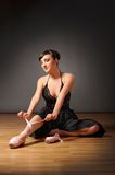 Ballerina sit on the floor Royalty Free Stock Photos