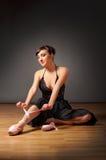 Ballerina sit on the floor. Young ballerina sit on the floor Royalty Free Stock Photos