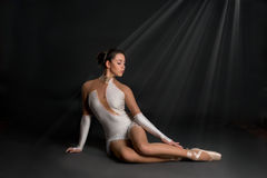 The ballerina  sits and has a rest. The ballerina in pointes sits and has a rest Stock Photos