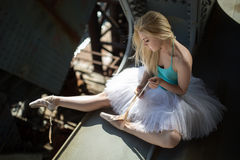 Ballerina sitting on the edge of bridge Royalty Free Stock Photography