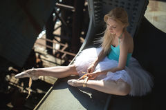 Ballerina sitting on the edge of bridge Royalty Free Stock Photo