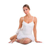 Ballerina sitting on the floor Royalty Free Stock Photography