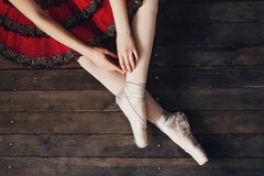 Ballerina sitting on the floor. Beautiful ballerina sitting on the floor Stock Photos