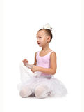 Ballerina sitting on floor Royalty Free Stock Photography