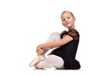 Ballerina sitting on floor Stock Photography