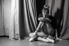 Ballerina sitting on the stage. black and white photo Stock Images