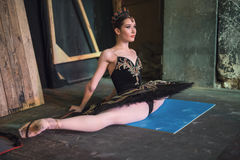 Ballerina sitting on the warm-up backstage Stock Images