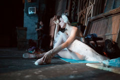 Ballerina sitting on the warm-up backstage Stock Photography