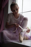 Ballerina sitting on windowsill Royalty Free Stock Photo