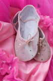 Ballerina slippers on tutu. Sparkling ballet slippers and bright pink tutu of a little girl Royalty Free Stock Photography