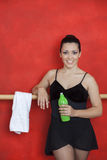 Ballerina Smiling While Holding Water Bottle In Training Studio Royalty Free Stock Photography