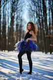 Ballerina in the snow. Ballerina dancing outdoor in the snow, in a forest Royalty Free Stock Images