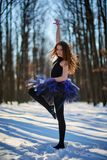 Ballerina in the snow. Ballerina dancing outdoor in the snow, in a forest Stock Images