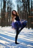 Ballerina in the snow. Ballerina dancing outdoor in the snow, in a forest Royalty Free Stock Photos