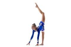 Ballerina som gör stående splittringar arkivfoto