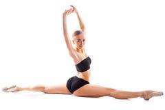 Ballerina in splits posing on white background Stock Image