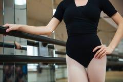 Ballerina standing in ballet class. Cropped image of ballerina standing in ballet class royalty free stock photos