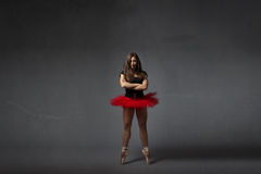 Ballerina standing with crossing arms royalty free stock image