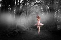 Composite image of ballerina standing en pointe stock photography