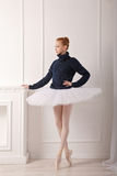Ballerina standing at fireplace Royalty Free Stock Photography