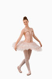 Ballerina standing in a pose. Against a white background Stock Photo