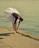 Ballerina straightens pointes Stock Image