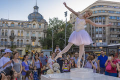 Ballerina on street stage Royalty Free Stock Photography