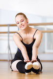 Ballerina stretches herself Stock Photo