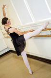 Ballerina stretching Royalty Free Stock Photo