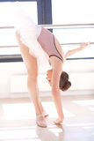 Ballerina Stretching at Barre in Dance Studio Stock Photos