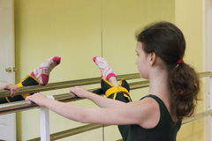 Ballerina stretching at the barre Stock Image